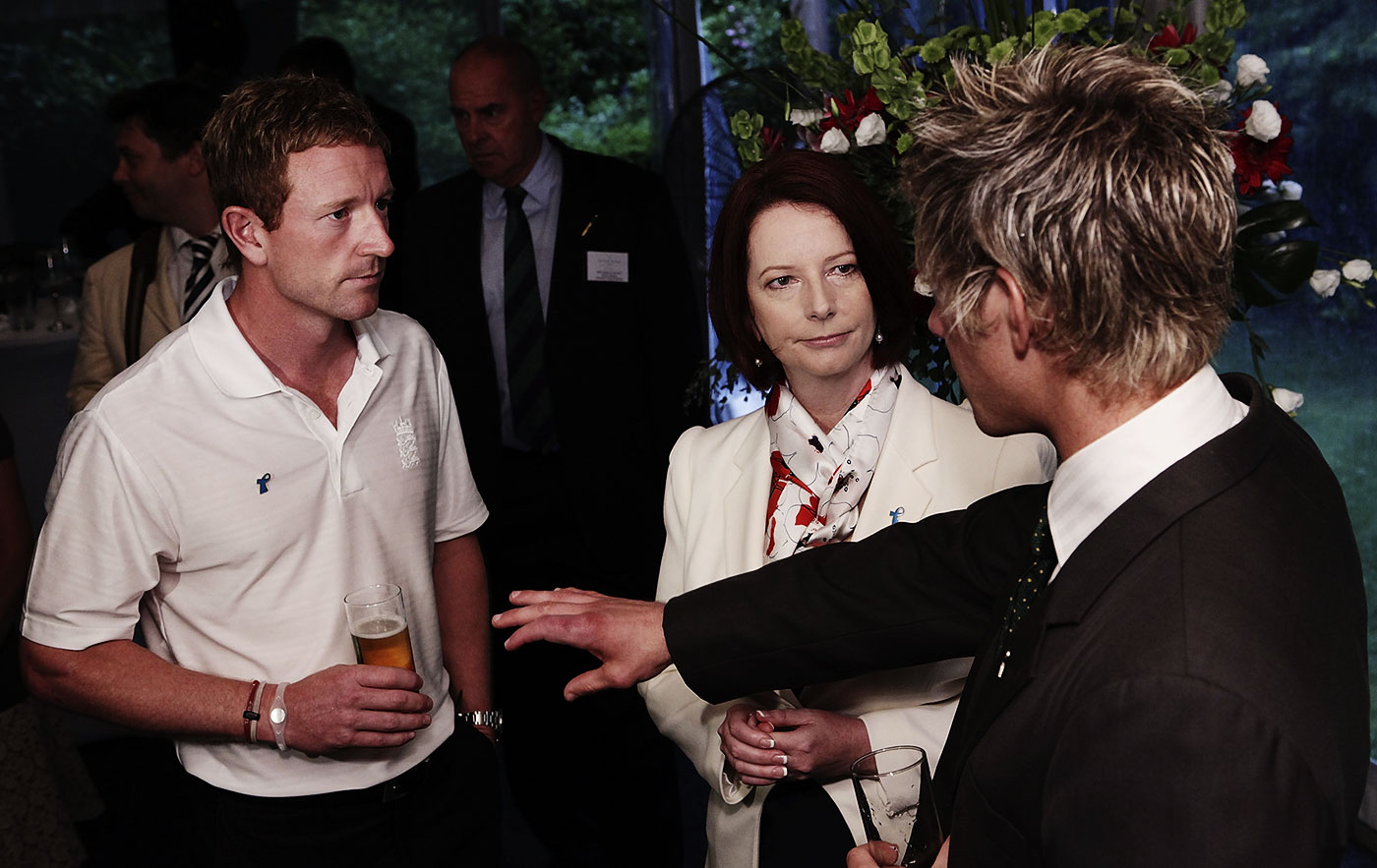 Paine talks to PM Julia Gillard and Paul Collingwood in January 2011, the day before he captained the Prime Minister's XI against England. (Note swollen finger)