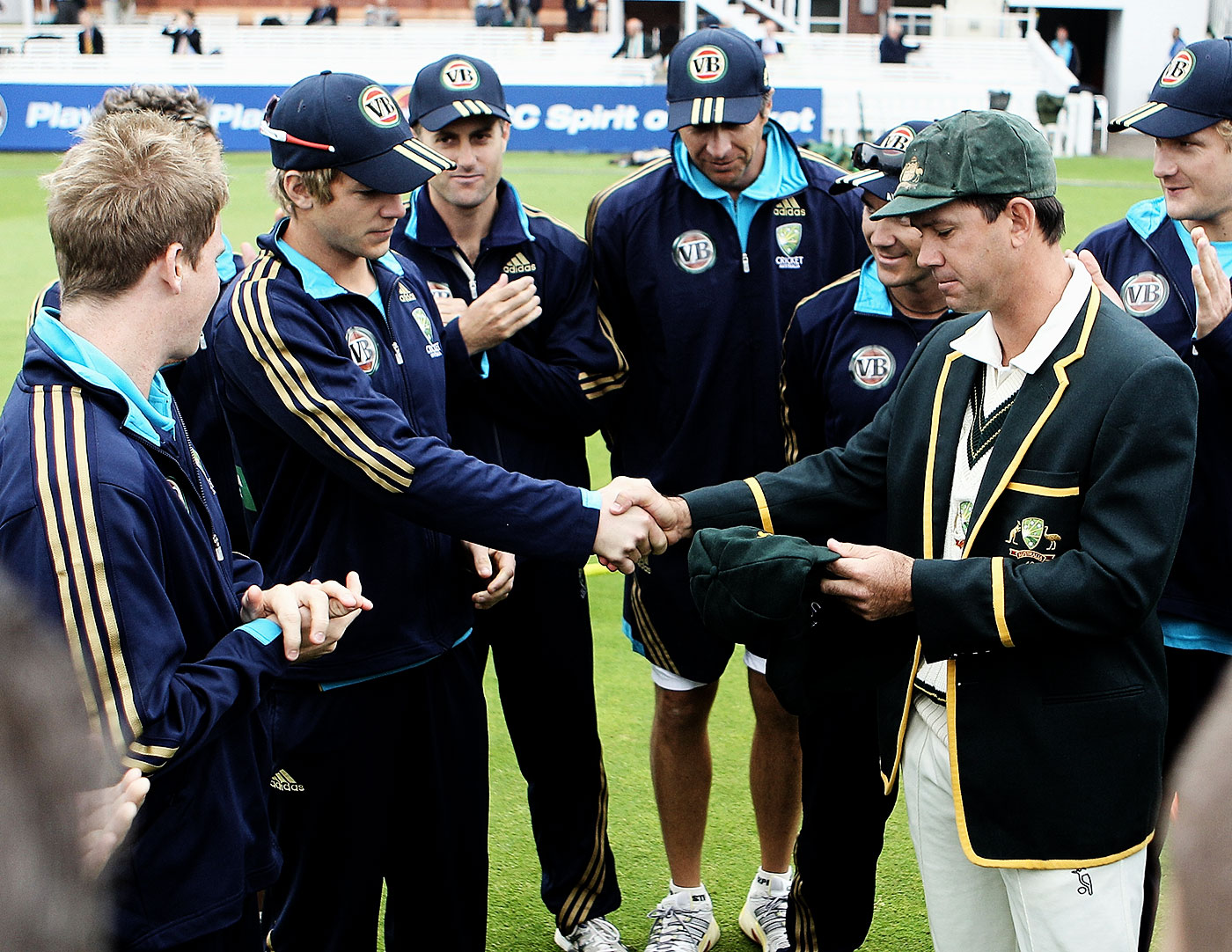 From one captain to another: Paine receives his baggy green from Ricky Ponting at Lord's in 2010