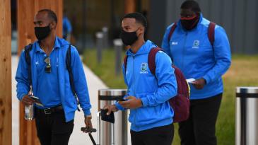 Kraigg Brathwaite, Shai Hope and Rahkeem Cornwall wear face masks