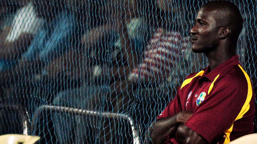 Daren Sammy watches the game from the boundary