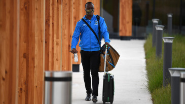 Kemar Roach arrives at Manchester Airport with his West Indies team
