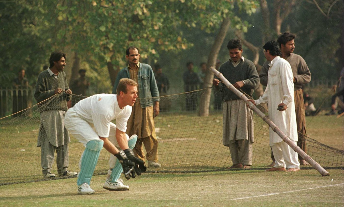 Net gains: Alec Stewart gets his training in, even as the nets are set up for a 1996 World Cup match at the Bagh-e-Jinnah Stadium in Lahore