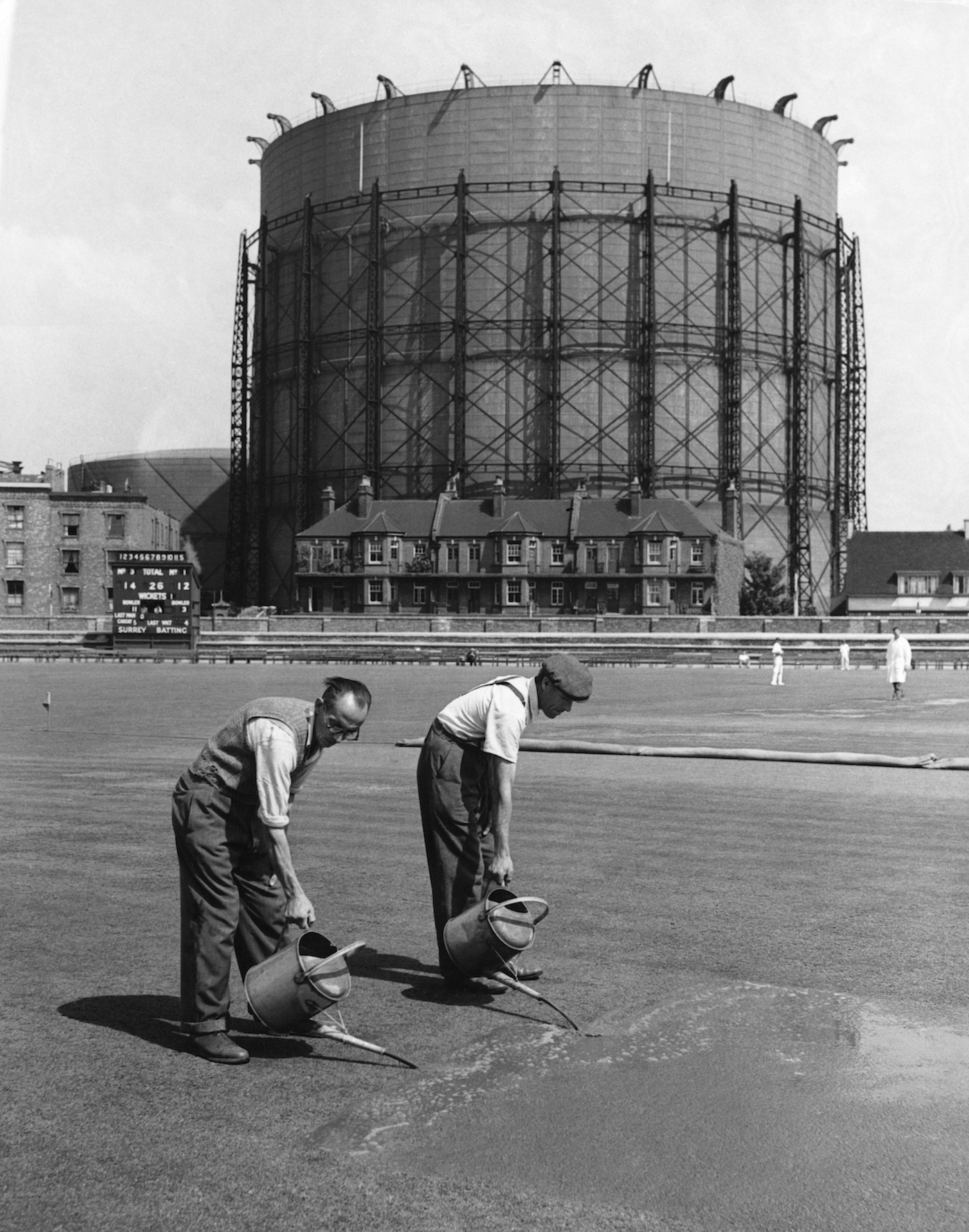 Workers water and fertilise the turf at The Oval before the final match of the 1953 Ashes