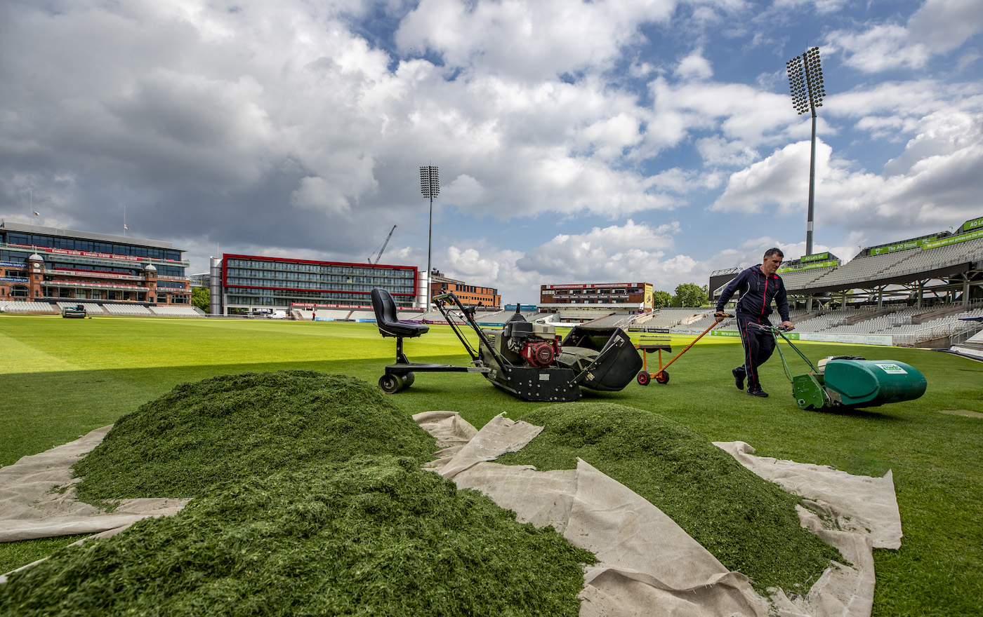 The head groundsman at Old Trafford mows the outfield in preparation for the West Indies Test series