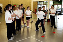 Ebony Rainford-Brent gives a coaching lesson to schoolgirls in Lambeth Hall, London, May 19, 2009