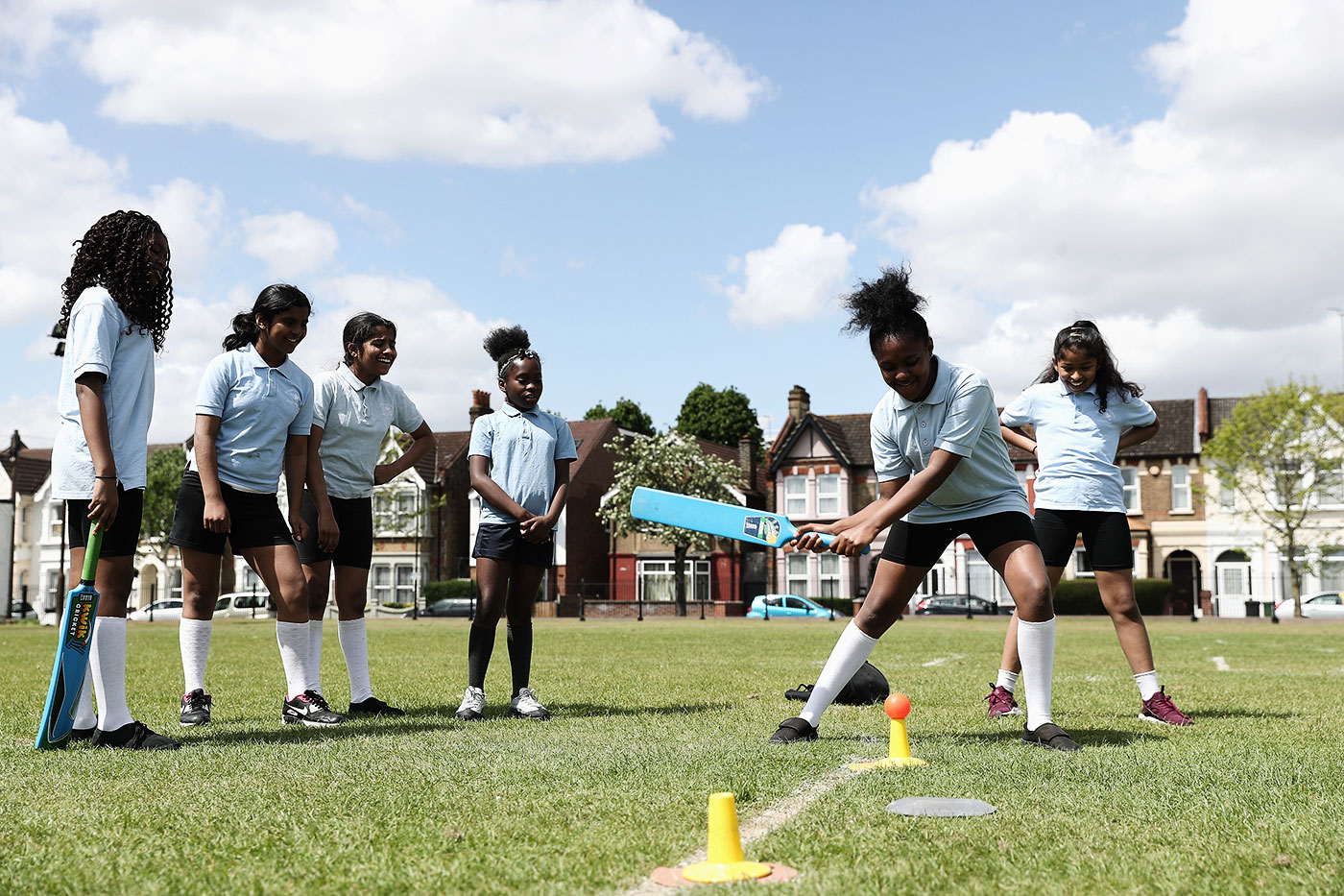 Girls participate in games of cricket during the launch of the South Asian Communities Action Plan in Leyton, London