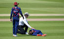 Umpire Alex Wharf checks on Keon Harding, who was injured while attempting to field the ball during day two of the intra-squad warm-up, Old Trafford, Manchester, June 24, 2020