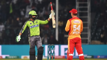 Mohammad Hafeez offers his bat up for testing after a particularly effective stroke