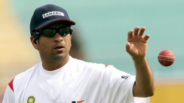 Sachin Tendulkar gets ready to bowl in a training session ahead of the first Test against Pakistan