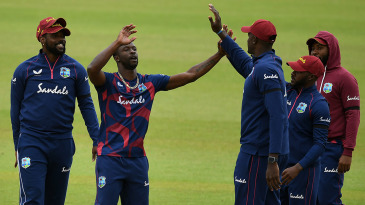 Kemar Roach celebrates with Jason Holder during Day Four of West Indies' final warm-up