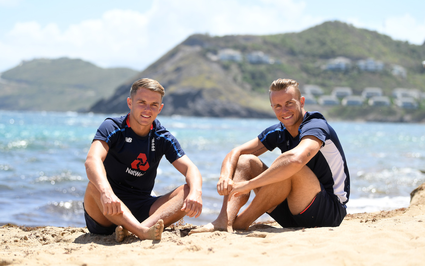 Sam and Tom Curran pose for a portrait on the beach