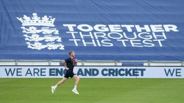 Ben Stokes trains in front of a banner covering the empty stands
