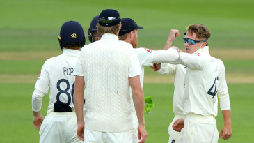 Dom Bess celebrates with his team-mates after taking the wicket of Shai Hope
