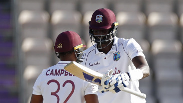 Jason Holder and John Campbell celebrate victory