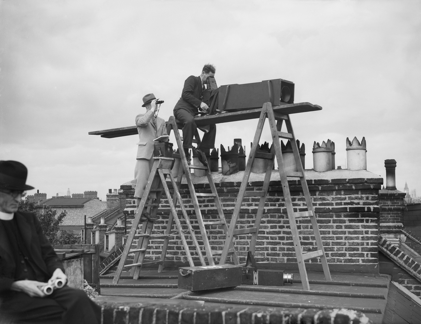 Fox Photos photographers use a long-focus lens mounted on a Graflex camera to capture the fifth Ashes Test at The Oval in 1938