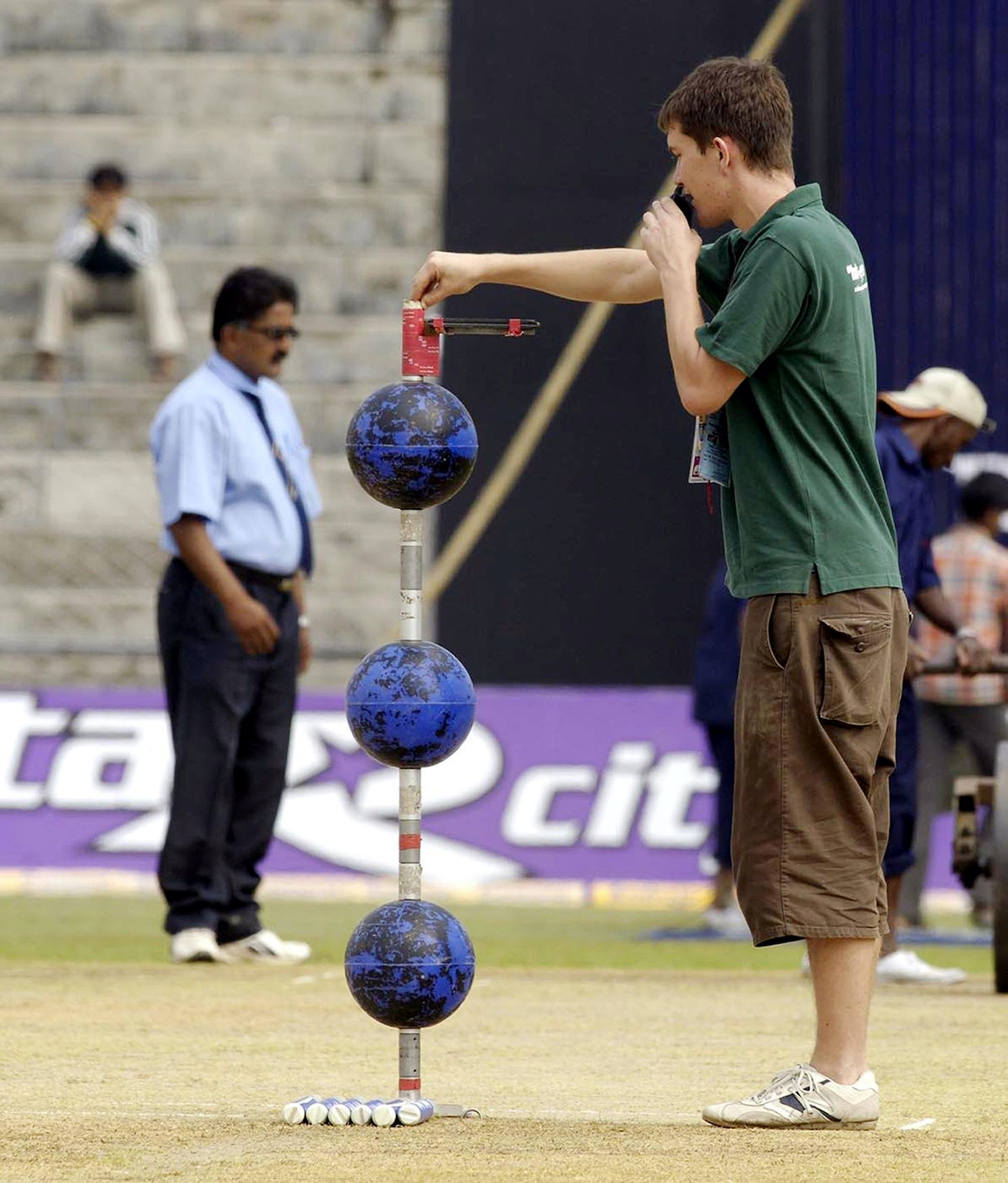 An operator sets up the Hawk-Eye system, calibrating it to the pitch in Guwahati, for the fifth ODI between India and England in 2006