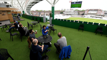 Surrey members watch the first Test from the rooftop bar at The Oval