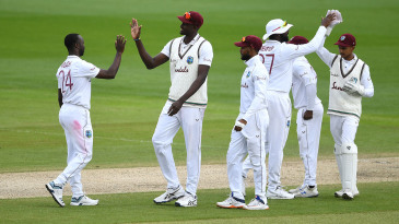 Kemar Roach celebrates after ending his wicket drought