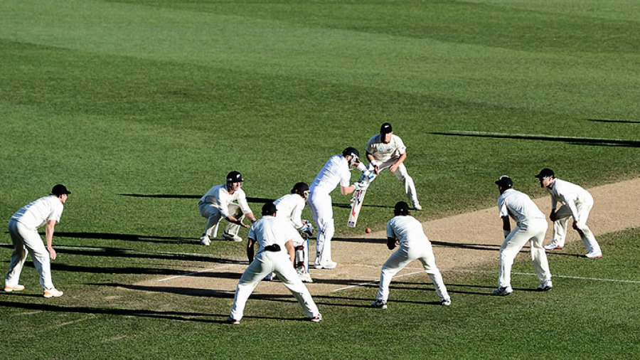 Matt Prior is surrounded by the New Zealand fielders as he blocks a ball from Kane Williamson