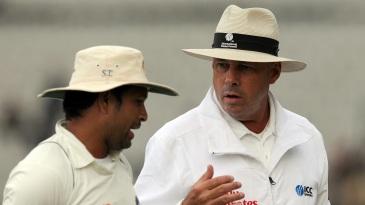 Sachin Tendulkar makes a point to Daryl Harper