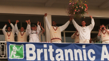 Leicestershire's celebrate news of their title on the balcony at Grace Road