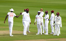 Rakheem Cornwall is congratulated by his captain on a slip catch, England v West Indies, 3rd Test, Old Trafford, 1st day, July 24, 2020