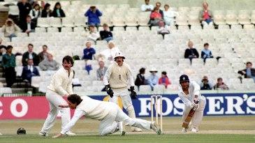 Sachin Tendulkar plays a shot past Allan Lamb and Robin Smith