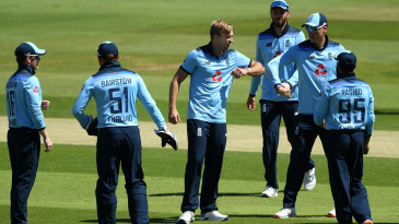 David Willey celebrates the wicket of Paul Stirling