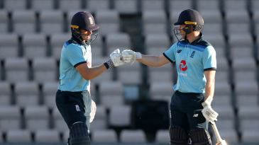 Sam Billings and Eoin Morgan touch gloves