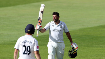 Tim Bresnan celebrates after scoring a century on his first class debut for Warwickshire