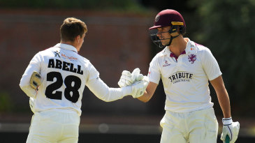Tom Abell is congratulated by Ben Green after reaching three figures
