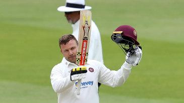 Adam Rossington celebrates his hundred for Northants