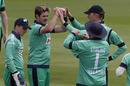 Mark Adair celebrates with teammates after bowling Jonny Bairstow, Ageas Bowl, August 4, 2020