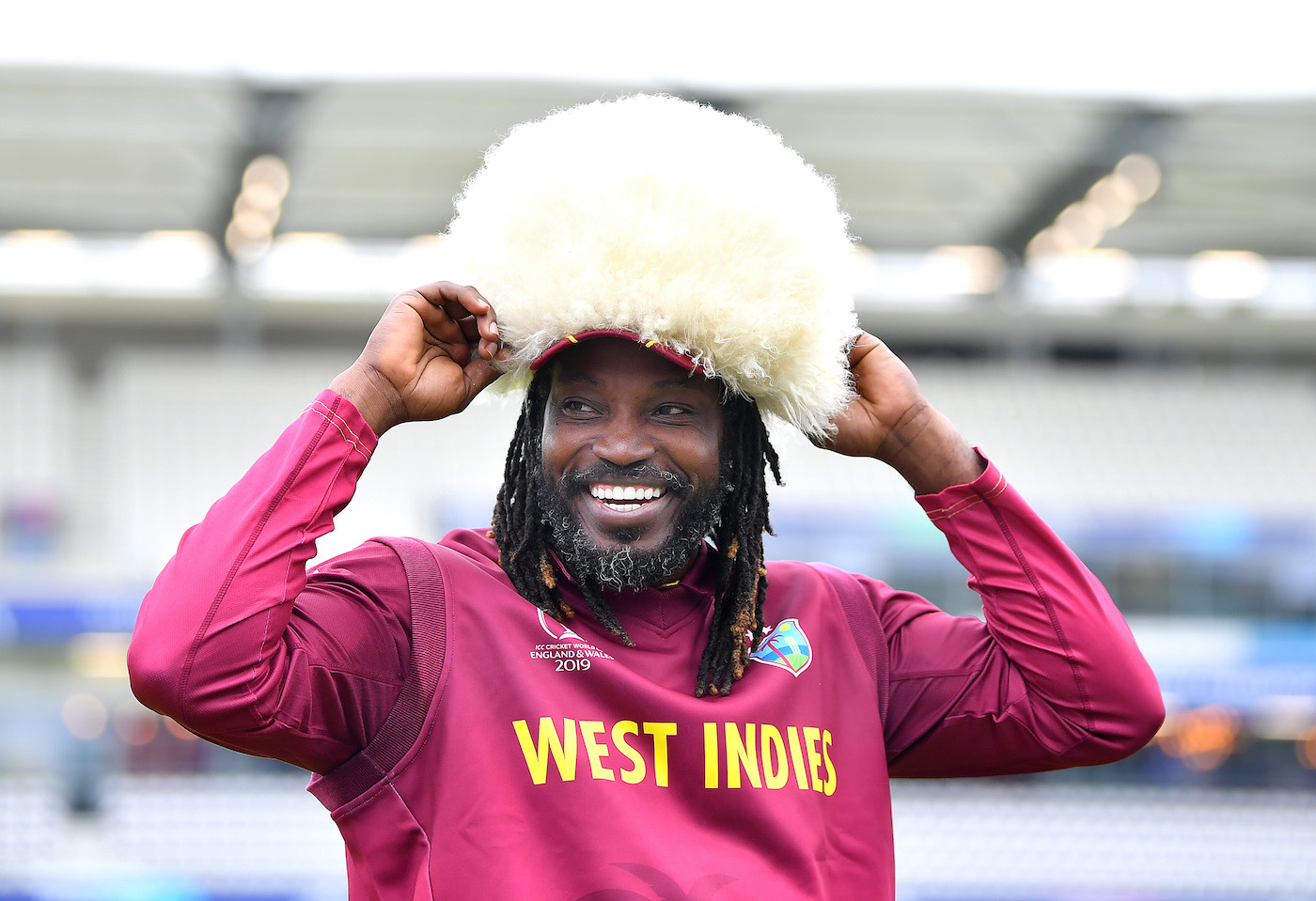 Chris Gayle caps West Indies' win over Afghanistan in the 2019 World Cup with a papakha borrowed from the opposition