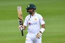 Babar Azam raises his bat upon reaching his half-century, England v Pakistan, 1st Test, Old Trafford, day 1, August 5, 2020