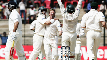 Shane Warne celebrates after bowling VVS Laxman
