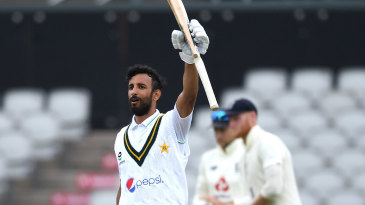 Shan Masood salutes the dressing-room after his hundred