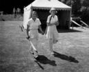 Betty Snowball (left) and T Dutton walk out to open the batting, Arundel Castle, Sussex, June 10, 1939