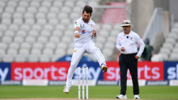 Yasir Shah punches the air after bowling Jos Buttler