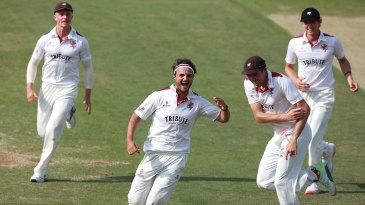 Jack Brooks celebrates with his Somerset team-mates