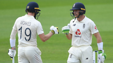 Jos Buttler and Chris Woakes punch gloves