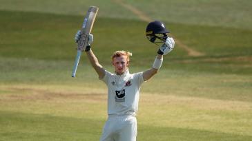 Jordan Cox celebrates his maiden first-class hundred