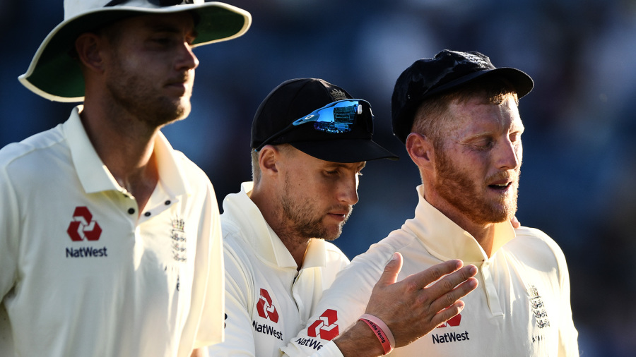 Stuart Broad, Joe Root and Ben Stokes leave the field