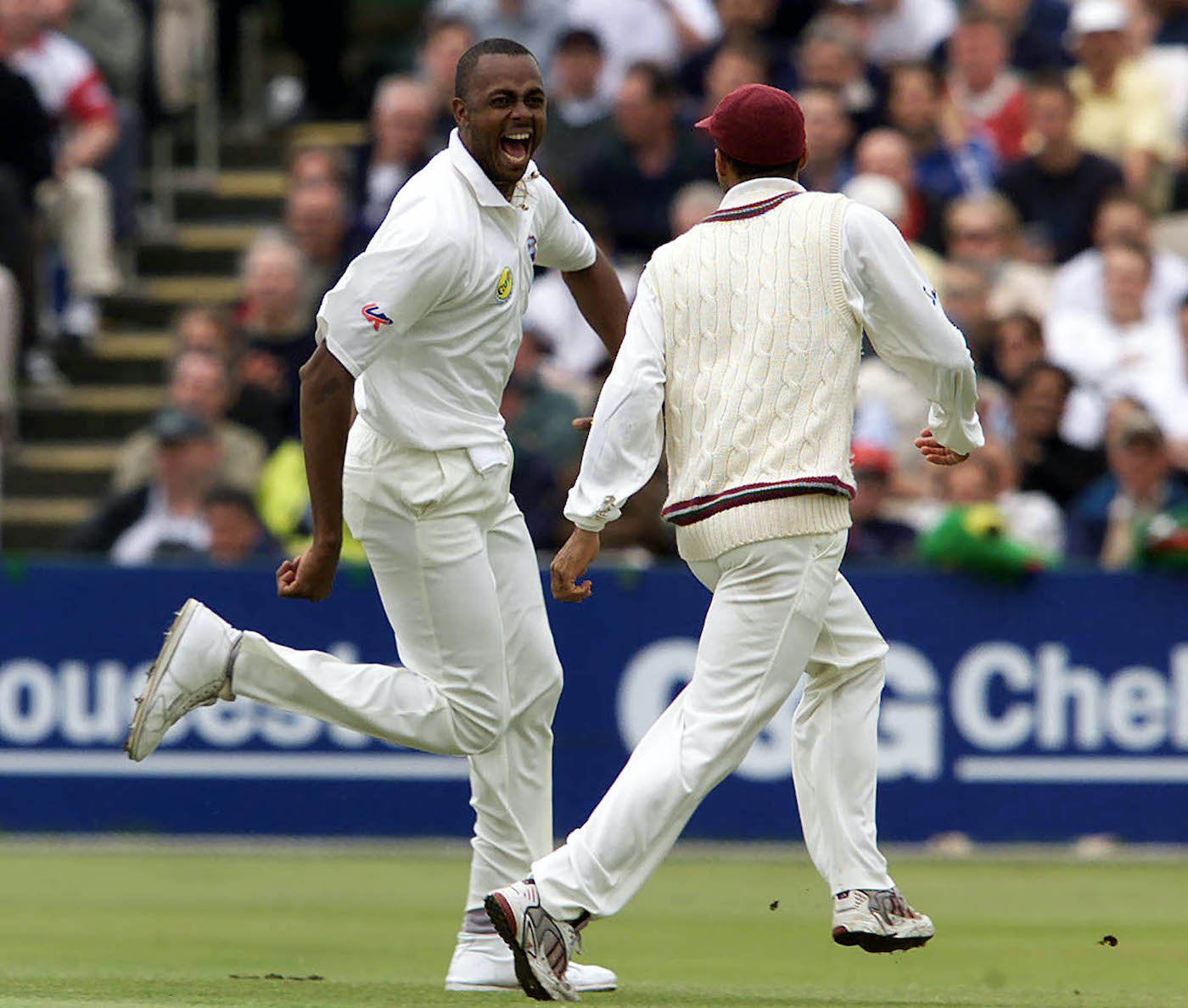 Courtney Walsh celebrates with Jimmy Adams after removing Nasser Hussain and Graham Thorpe in successive balls