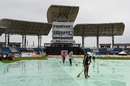 The groundstaff clear water from the covers ahead of CPL 2020's opening match, Trinbago Knight Riders v Guyana Amazon Warriors, CPL 2020, Trinidad, August 18, 2020