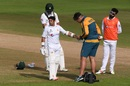 Abid Ali receives treatment from the Pakistan physio after copping a painful blow on his left hand from James Anderson, England v Pakistan, 3rd Test, Southampton, 4th day, August 24, 2020