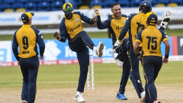 Mohammad Nabi celebrates a wicket with his team-mates