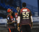 Khary Pierre celebrates a breakthrough with Tion Webster and Kieron Pollard, Trinbago Knight Riders v Guyana Amazon Warriors, Port-of-Spain, CPL, August 27, 2020
