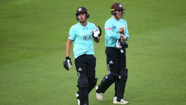 James Taylor and Matt Dunn trudge off after Surrey