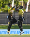 Mujeeb Ur Rahman and Rovman Powell celebrate a wicket, Barbados Tridents v Jamaica Tallawahs, CPL 2020, Port of Spain, August 26, 2020